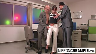 Young new office intern gets initiated with two hard cocks