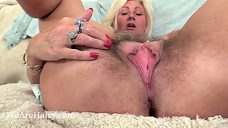 Ellen B relaxes with her purple toy and orgasms
