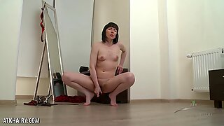 Cherry Despina is hot when she fingers her hairy pussy