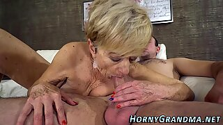 Blonde granny sucks dick